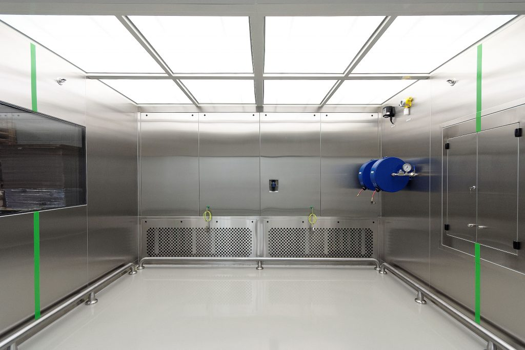 /></figure><h3><strong>Containment booths</strong></h3><p>Containment booths may be used for the safe off-loading of hazardous material from dryers and centrifuges.<br />Using a pack-out station from our standard range for primary containment and the booth itself for secondary containment, therefore high levels of operator and product protection can be achieved. In other words, with specific reference to operator protection, O.E.L.s of <10ug/m3 are easily achievable. A number of options and features include:</p><ul><li>Through Floor Off-Loading</li><li>Pack-Off Stations</li><li>Single Pass and re-circulatory air through</li><li>B.M.S. interface</li><li>Weigh scales</li><li>Flush mount displays</li><li>Hazardous area electrics incl. ATEX certification</li></ul><h3><strong>Solvent Booths</strong></h3><p>Used mainly in primary pharmaceutical operations, solvent handling booths offer a safe user friendly solution to liquid transfer.<br />Based on a single pass or once through design with horizontal laminar airflow, containment is assured by operating the system under a monitored negative pressure.<br />Options and Features include:</p><ul><li>Sliding front sash to drum entry door</li><li>Lance and weigh equipment</li><li>Spillage sump</li><li>Clear solid and or HFW clear flexible side walls</li><li>Built-In gauntlets</li><li>Roller conveyors</li></ul><p><span style=